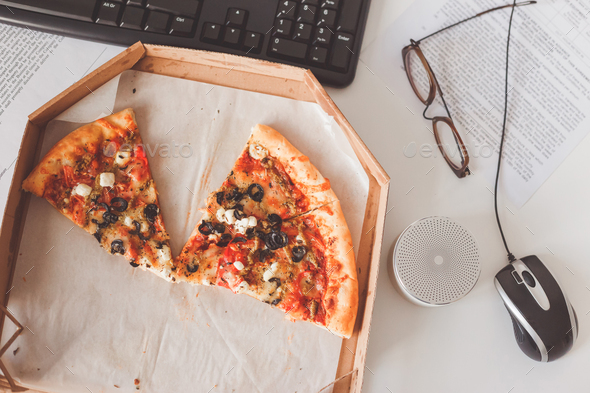 Vegetarian pizza on office table. Business lunch at work - Stock Photo - Images