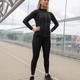 Pretty Woman in Black Workout Wear Standing At Modern Bridge In City - PhotoDune Item for Sale