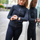 Woman using fitness smart watch device before running in city - PhotoDune Item for Sale