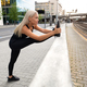Perfect looking Urban Female Stretching Her Leg Before Exercise - PhotoDune Item for Sale