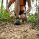 Ultramarathon runner tying shoelace in rainforest - PhotoDune Item for Sale