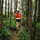 Woman ultramarathon runner running in tropical rainforest - PhotoDune Item for Sale