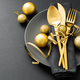 Gold cutlery served on plate for Christmas Dinner - PhotoDune Item for Sale