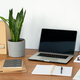 Workplace of office manager with laptop, potted plant, notebooks and books - PhotoDune Item for Sale