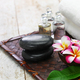 tropical spa resort concept; plumeria, hot stones, towels, and massage oils - PhotoDune Item for Sale