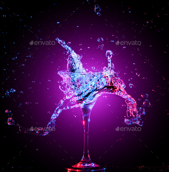 Colourful cocktail in glass with splash - Stock Photo - Images