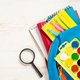 School backpack with stationery on white background - PhotoDune Item for Sale