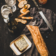 White wine, baguette, cheese and jam over dark background - PhotoDune Item for Sale