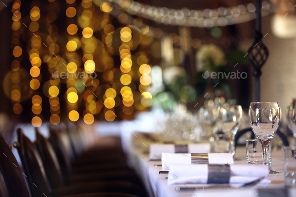 Formal wedding place setting on long table background - Stock Photo - Images