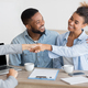 Cheerful afro spouses and finansial counselor handshaking in office - PhotoDune Item for Sale