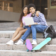 Couple of black teens sitting on stairs with laptop - PhotoDune Item for Sale