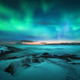 Aurora borealis over rocky beach and ocean. Northern lights - PhotoDune Item for Sale