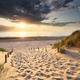 golden sunset light over sand path to North sea beach - PhotoDune Item for Sale