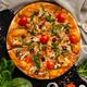 Fresh pizza with cherry tomatoes on dark table - PhotoDune Item for Sale