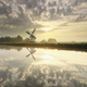 sunrise over white Dutch windmill and river - PhotoDune Item for Sale