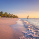Sandy beach with sea waves, palm trees and walking people - PhotoDune Item for Sale