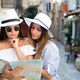 Young happy tourist women travelling on summer vacation. Travel, friends, summer concept - PhotoDune Item for Sale