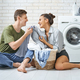 loving couple is doing laundry - PhotoDune Item for Sale