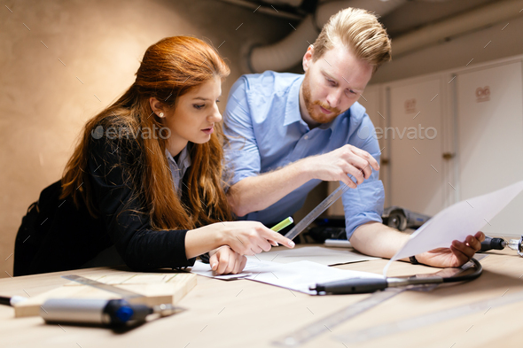 Designers working in modern office - Stock Photo - Images
