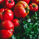 Brandywine sort tomatoes with greens for seasonal salad on a table - PhotoDune Item for Sale