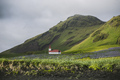 Church on a hill next to mountains in Vik, Iceland - PhotoDune Item for Sale