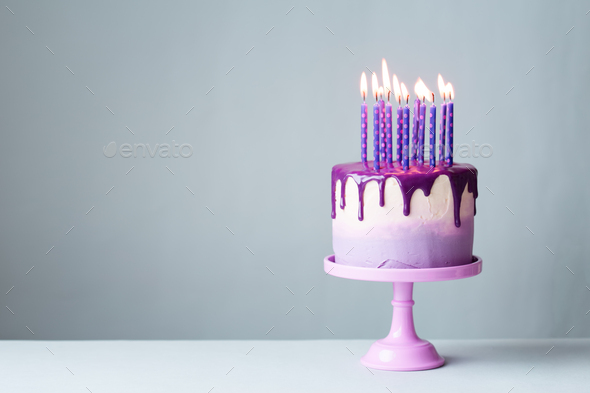 Birthday Cake With Candles.Birthday Cake With Drip Icing And Purple Candles