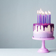 Birthday cake with drip icing and purple candles - PhotoDune Item for Sale