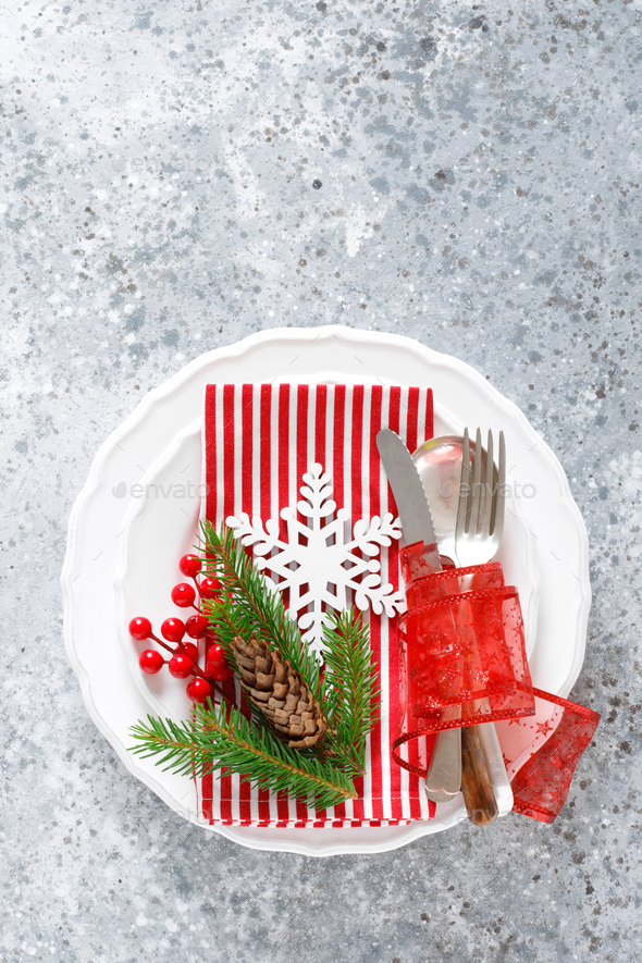 Christmas table setting with empty festive white plate and cutlery - Stock Photo - Images