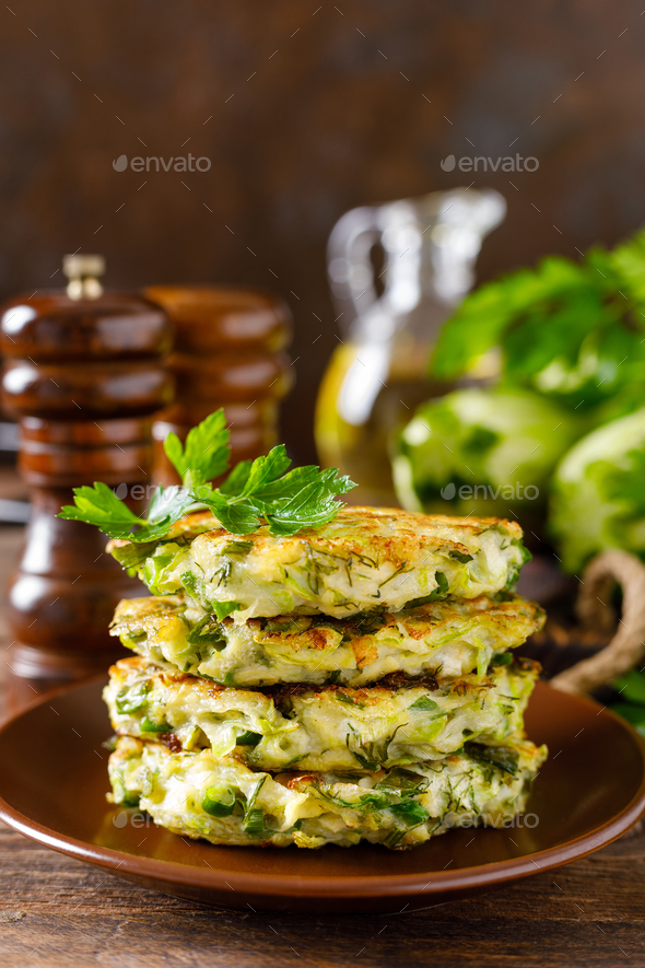 Vegetable fritters with zucchini and greens - Stock Photo - Images