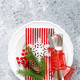 Christmas table setting with empty festive white plate and cutlery - PhotoDune Item for Sale