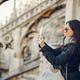 girl using her phone while exploring Milan Italy - PhotoDune Item for Sale