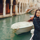 girl talking on the phone and taking pictures in Venice - PhotoDune Item for Sale