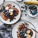 Healthy breakfast with banana pancakes and coffee, top view - PhotoDune Item for Sale