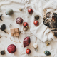 Flat-lay of Christmas festive decoration toys and tiger cat - PhotoDune Item for Sale
