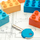 Colorful building blocks and home key on housing plan. Building house concept - PhotoDune Item for Sale