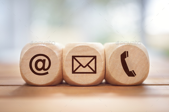 Contact us concept with wood block and symbols - Stock Photo - Images