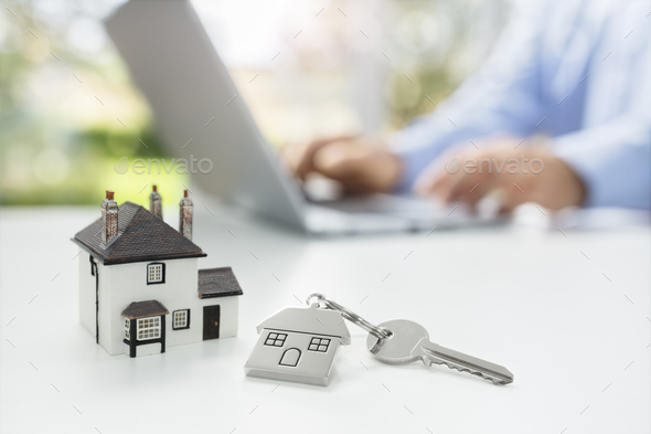 Searching the internet for real estate or new house - Stock Photo - Images