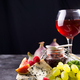 Assortment of cheese, berries and grapes with red wine in glasses. on stone background. Copy space - PhotoDune Item for Sale