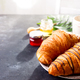 Breakfast on white wooden background - croissant, jam, berries and coffee, copy space - PhotoDune Item for Sale