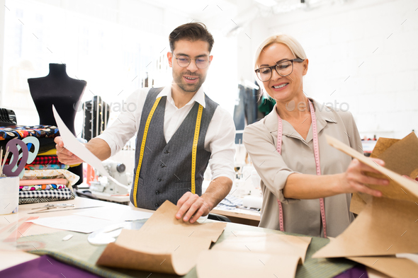 Tailors Enjoying Work in Atelier - Stock Photo - Images