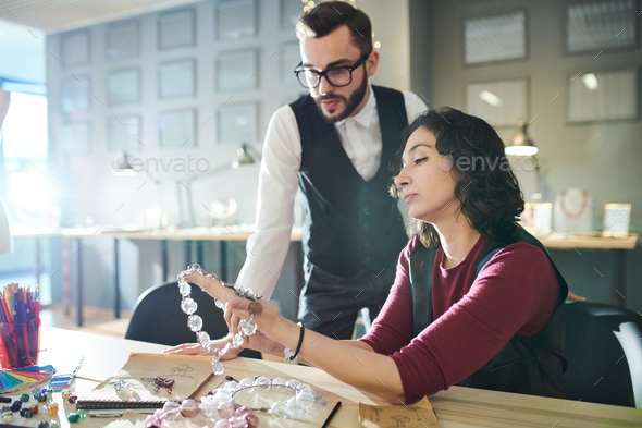 Stylists Discussing Glass Jewelry - Stock Photo - Images