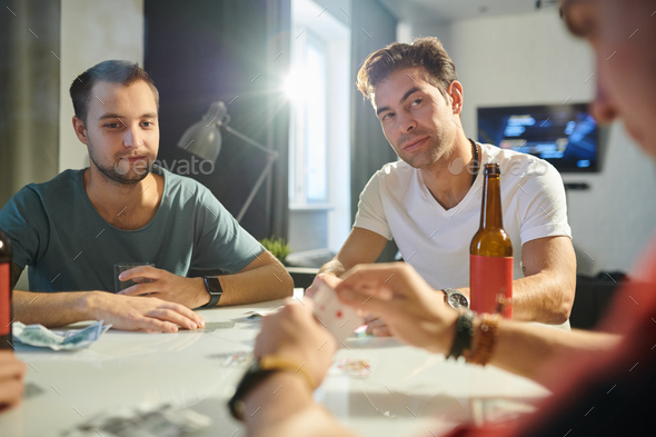 Men playing cards - Stock Photo - Images