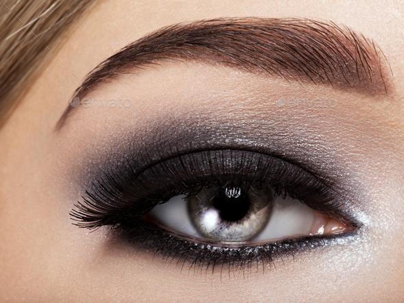 woman's eye with black eye makeup. Macro style image - Stock Photo - Images
