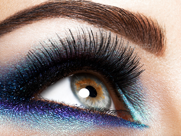 Woman's eye with blue eye makeup - Stock Photo - Images