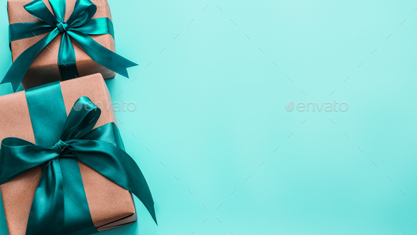 Gift boxes in craft paper and satin ribbon, banner - Stock Photo - Images