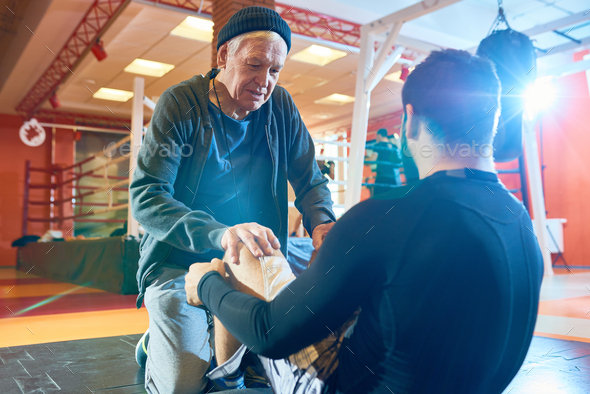 Elderly trainer working out with man - Stock Photo - Images