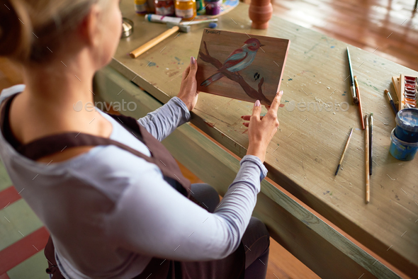 Female Artist Holding Painting - Stock Photo - Images