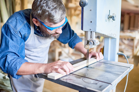 Carpenter Cutting Wood in Joinery - Stock Photo - Images