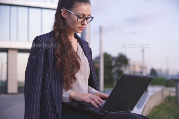 Young woman working on laptop - Stock Photo - Images