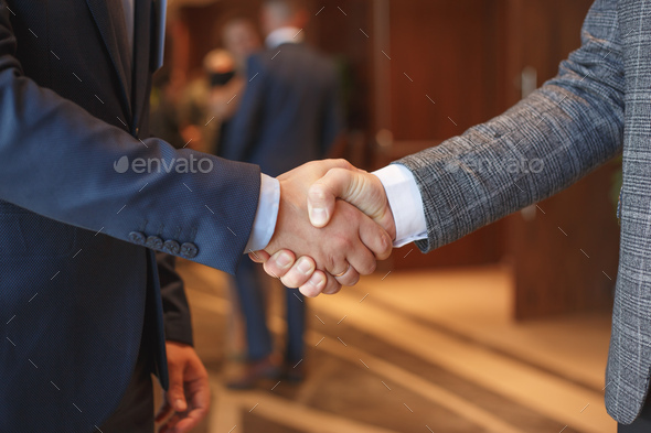 Men shake hands at business meeting - Stock Photo - Images